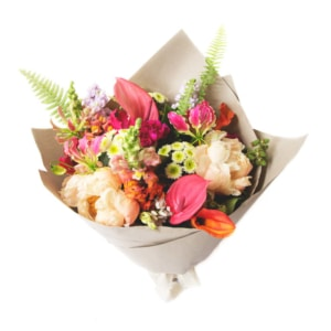 Tropical Bouquet with lush jungle foliage and colourful flowers with fern frond textures.